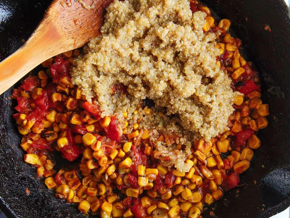 quinoa added to pan with corn, tomatoes, taco seasoning, etc.