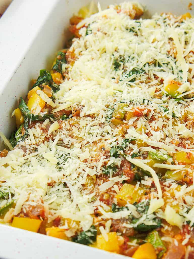 layer of vegetable mixture plus shredded cheese added to previous layers in casserole dish