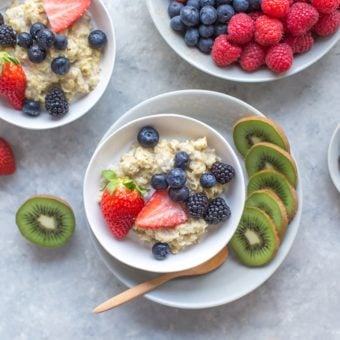 oatmeal with fresh berries in a white bowl, top view