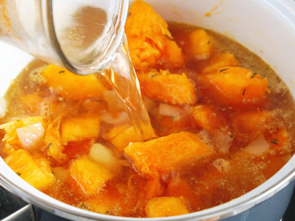 butternut squash and stock added to garlic/onion mixture