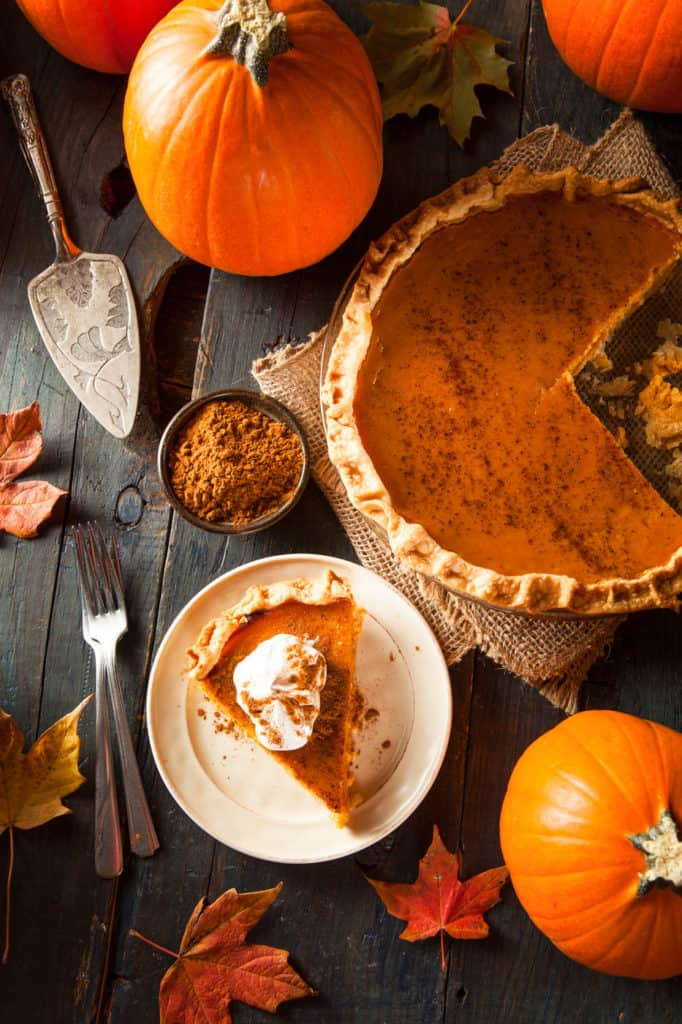 healthy pumpkin pie, low calorie, gluten free option - slice of pumpkin pie cut and served on a white plate, top view
