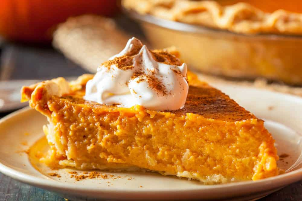 healthy pumpkin pie, low calorie, gluten free option - slice of pumpkin pie cut and served on a white plate