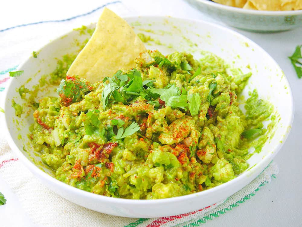 guacamole recipe in bowl with chip
