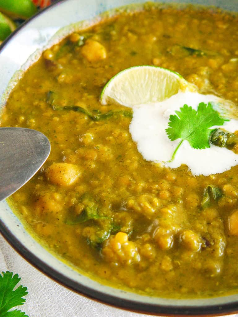 closeup of indian lentil soup with greek yogurt and lime