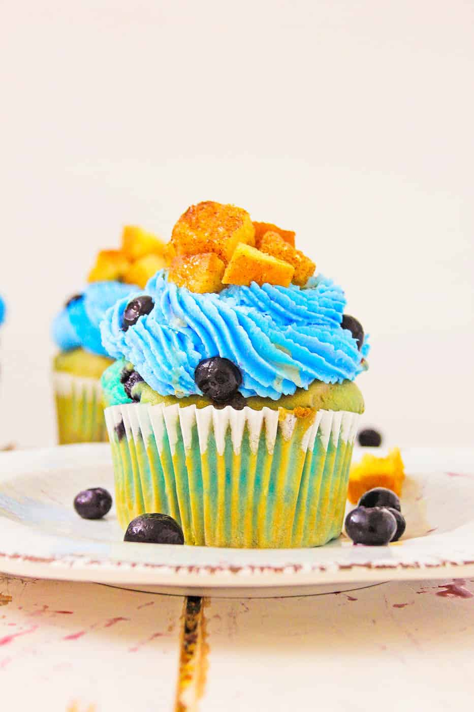 Blueberry Lemonade Cupcakes With Lemon Cream Cheese Frosting with french toast cubes on top
