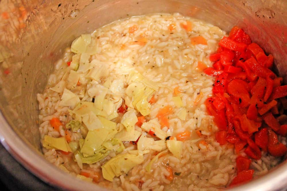 instant pot risotto ingredients with added red peppers and artichokes