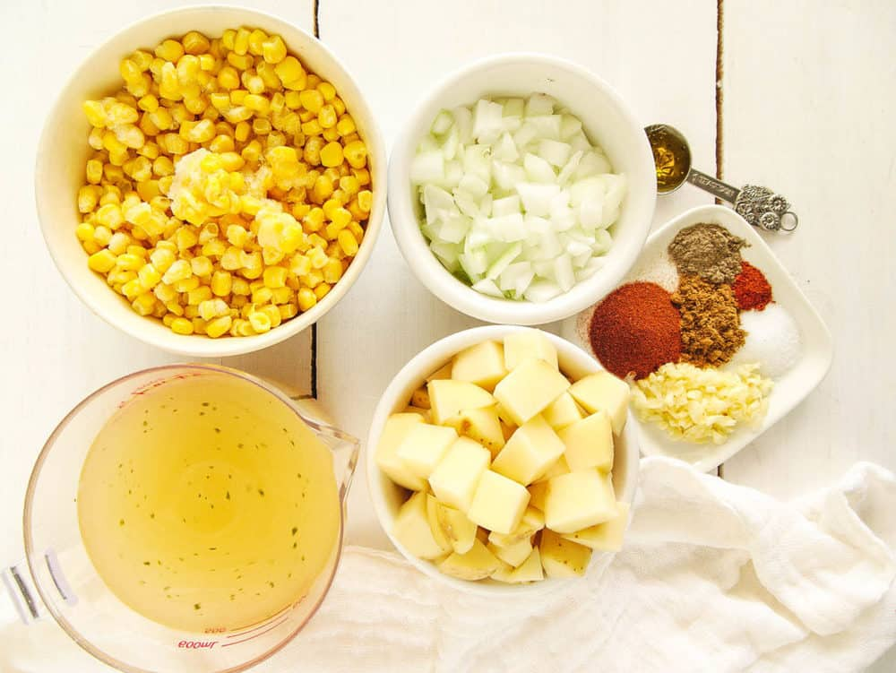 ingredients for potato corn chowder - corn, potatoes, onions, broth, spices