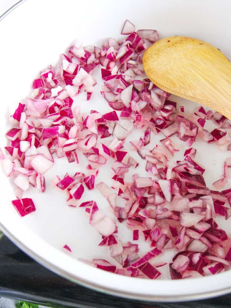 onions sauteeing in a pot