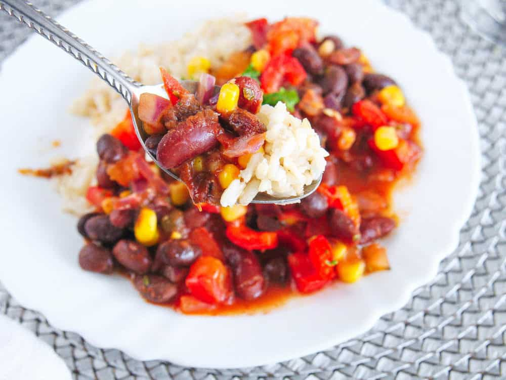 spoonful of vegetarian stew recipe with beans and rice