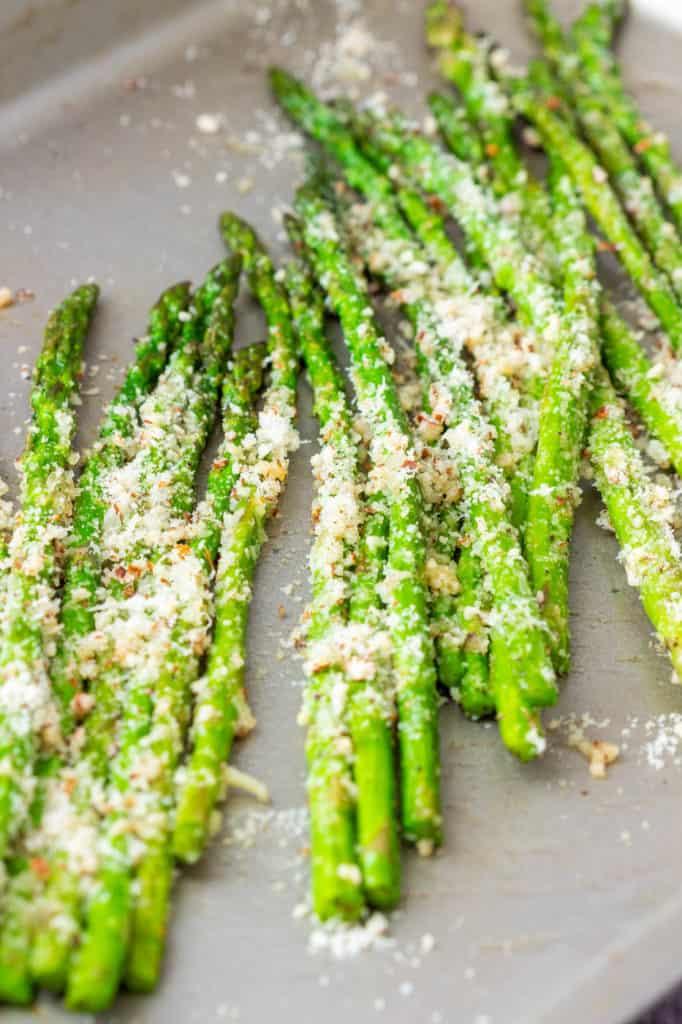 asparagus with pecorino, on a baking sheet