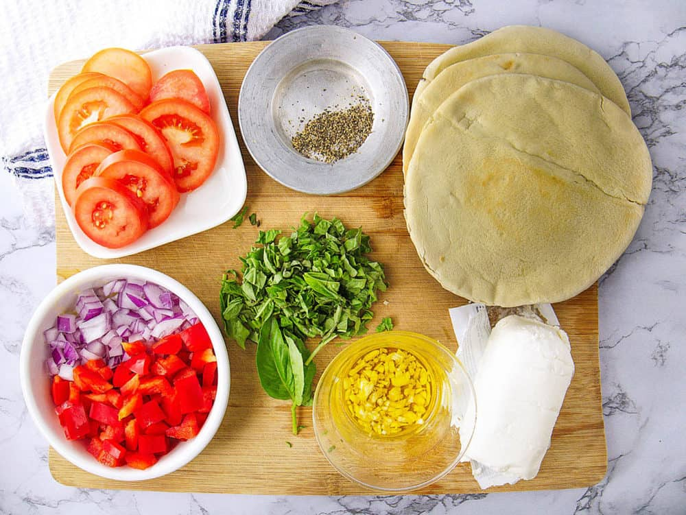 ingredients for healthy pita pizzas with goat cheese