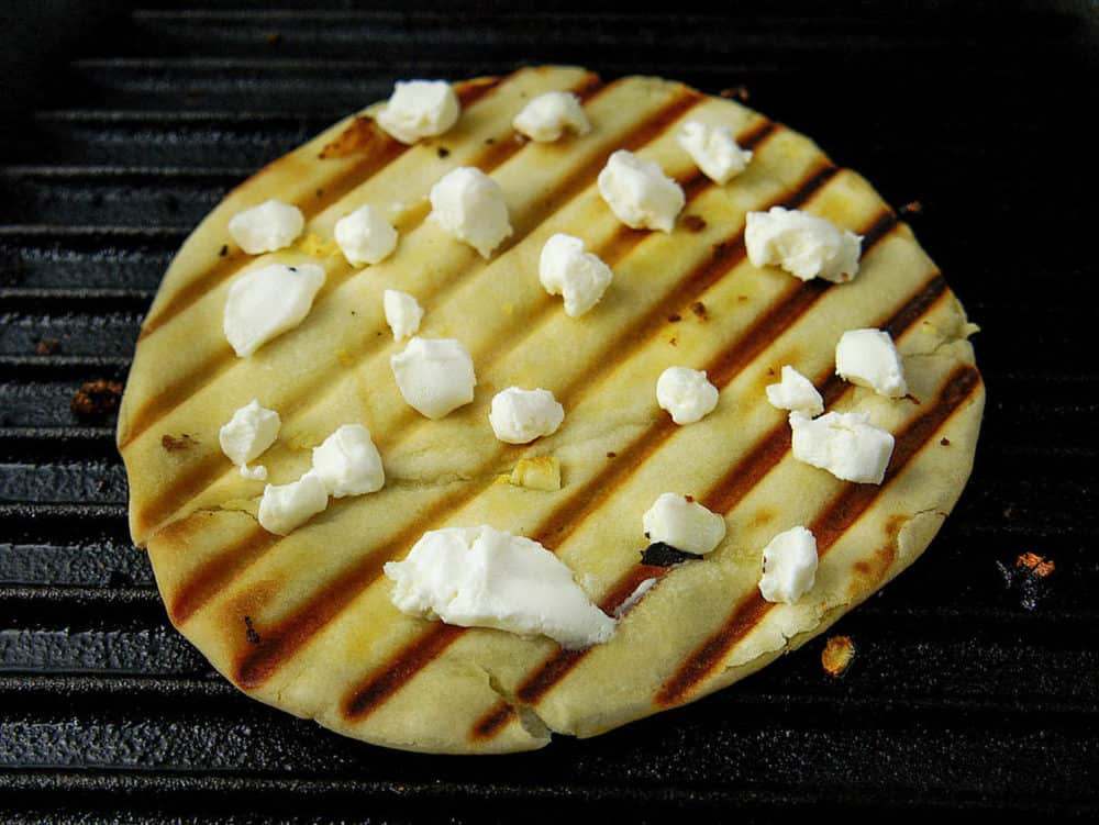 pita bread grilled with goat cheese on top