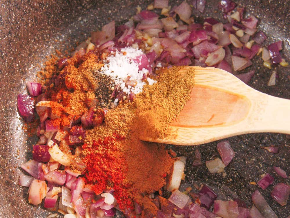 spices added to onions and garlic