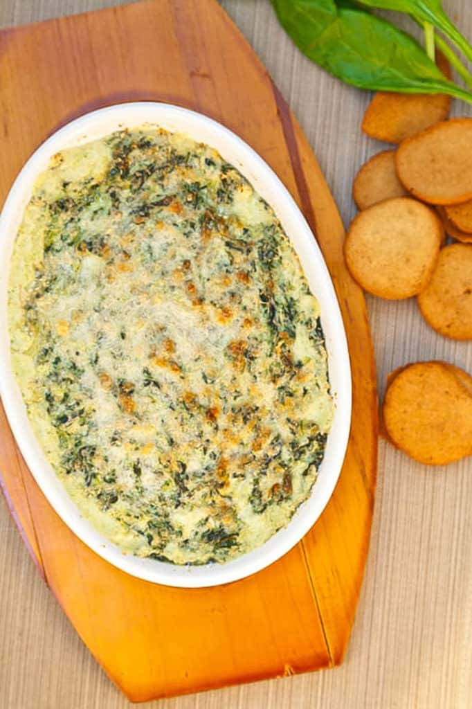 Healthy Cheese Dip with Smoky Onion and Kale served in a white baking dish