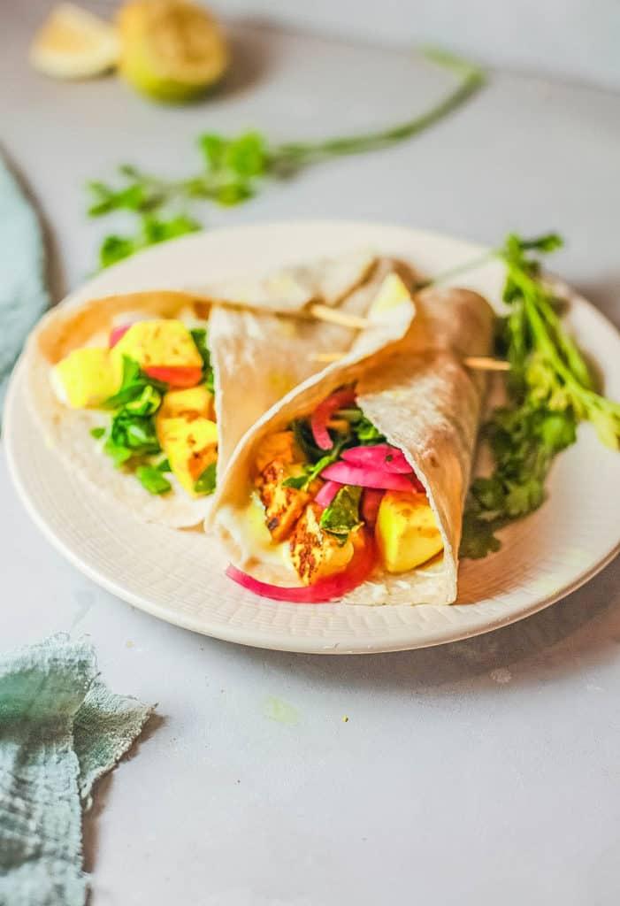 veggie shawarma with marinated tofu, served on a tan plate