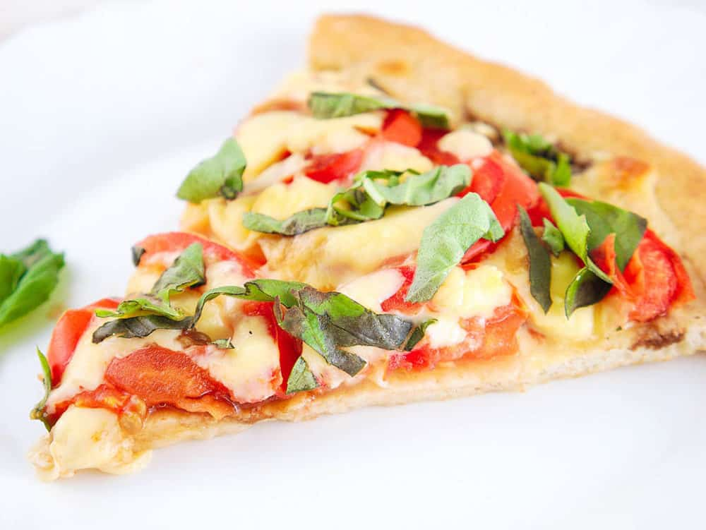 slice of margherita flatbread pizza