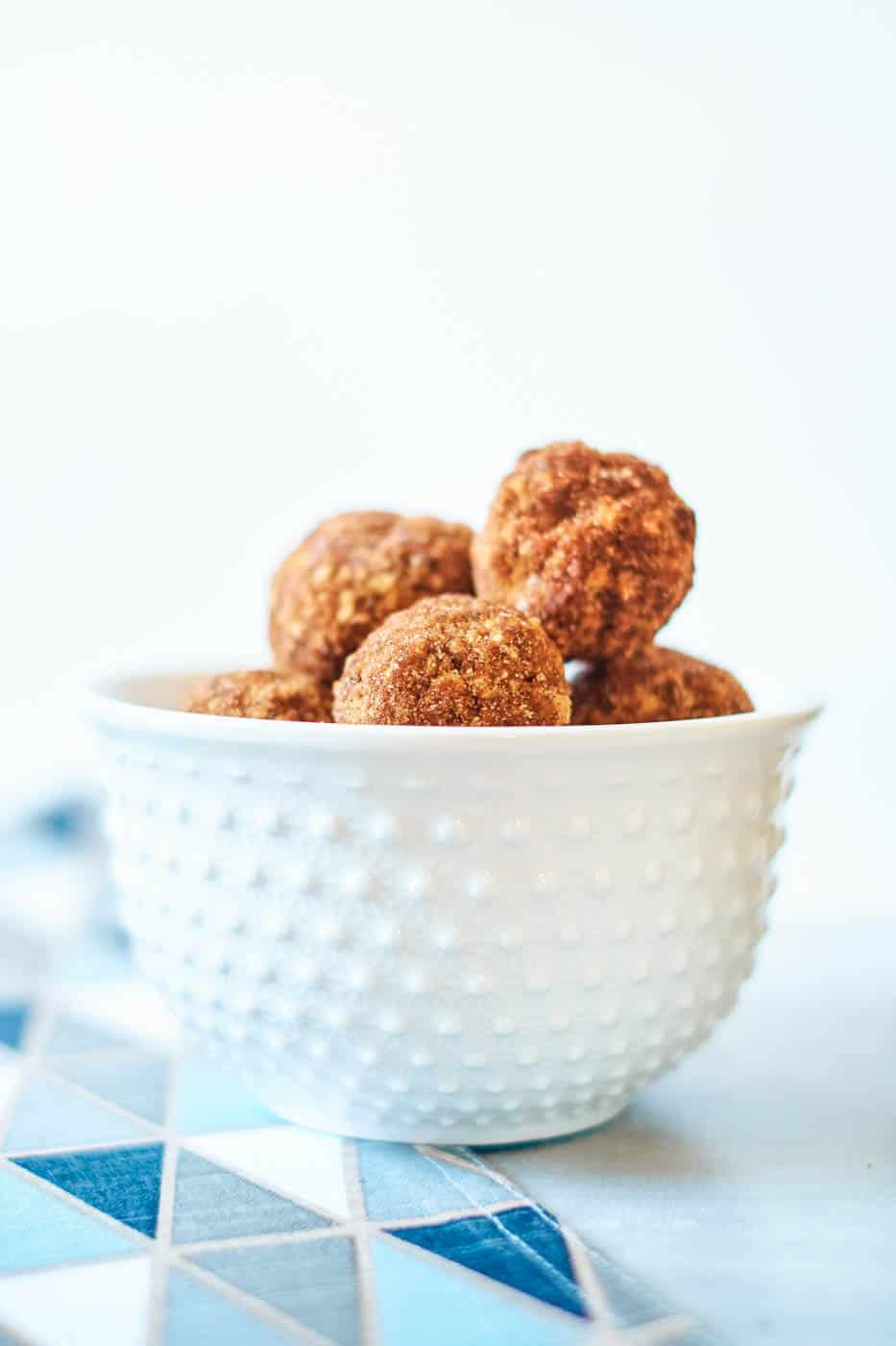 vegan chocolate truffles in a white bowl with blue napkin