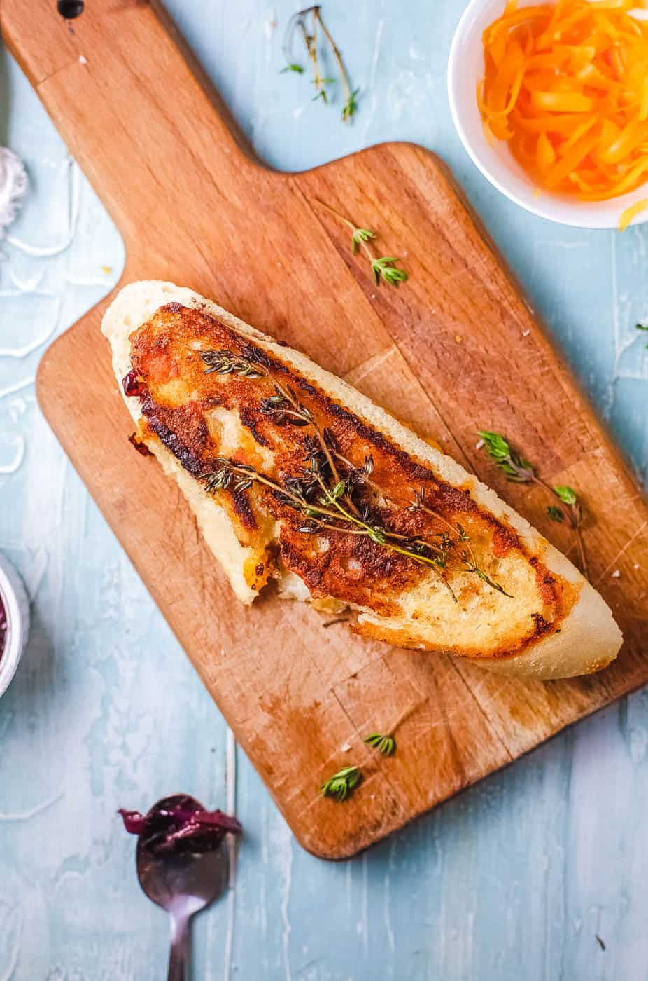 top view of garlic bread grilled cheese on a wooden cutting board
