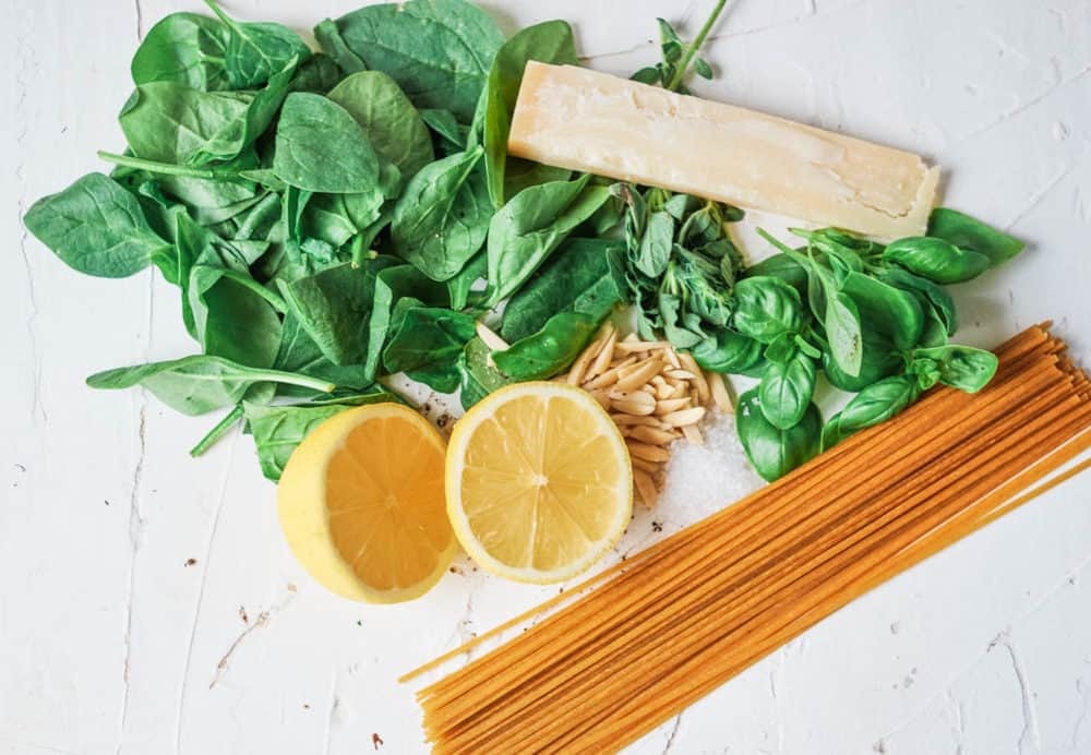 ingredients for recipe - spinach, lemon, herbs, pasta, cheese
