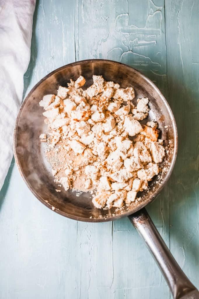 tofu crumbled in a pan