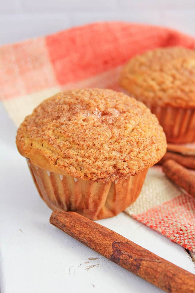 cinnamon muffins fresh out of the oven against a white background