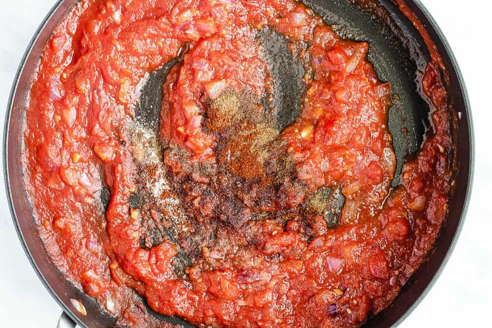 tomatoes cooking in a large pot