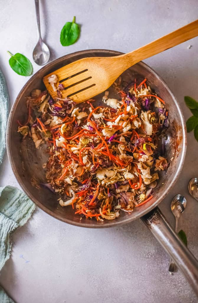 tofu added to cabbage in a pan