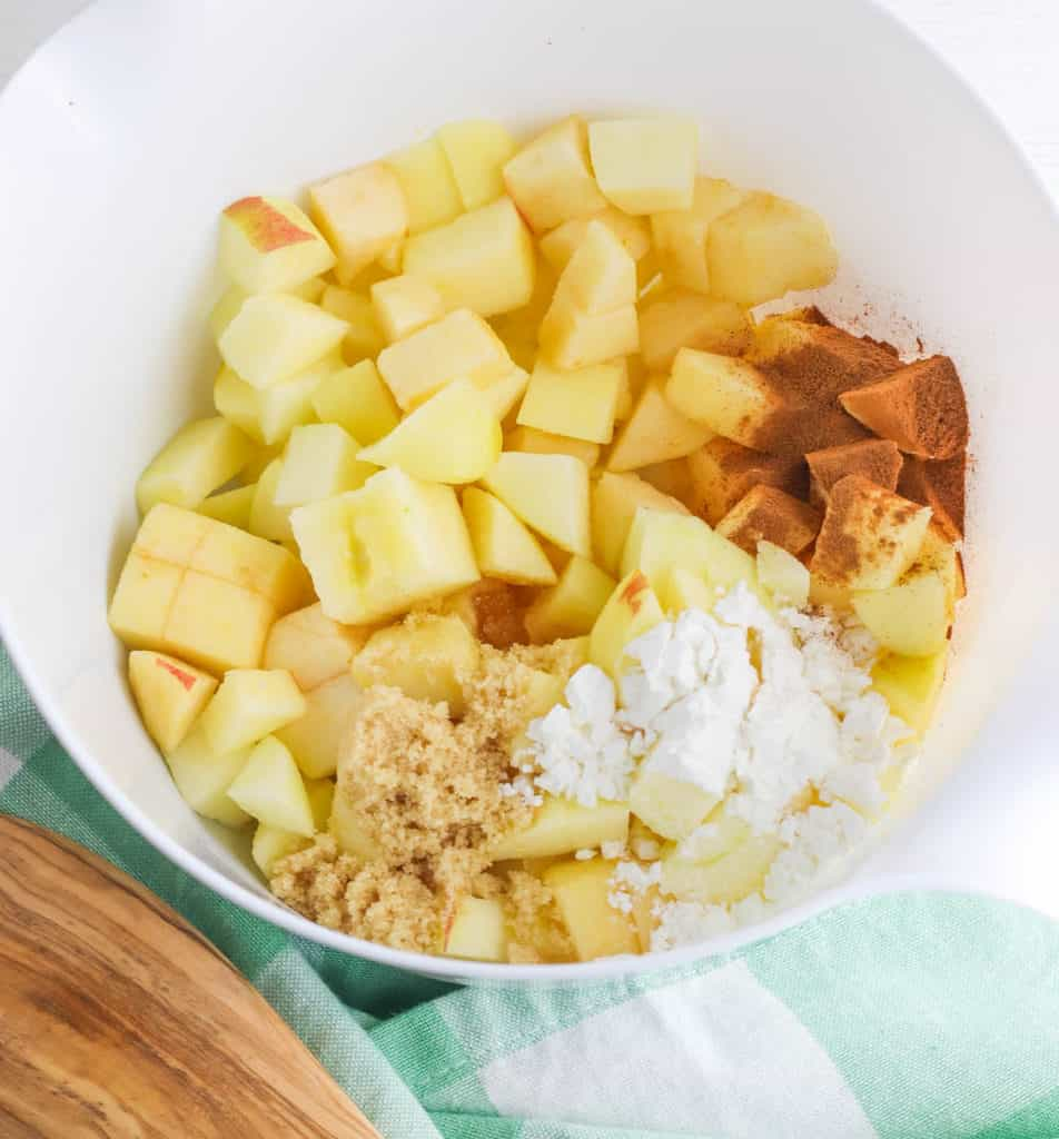 ingredients for apple crisp in a white bowl