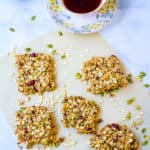 homemade healthy flapjacks, cut into squares and pictured on a sheet of parchment paper