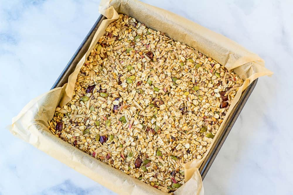 baking dish lined with parchment with vegan flapjacks