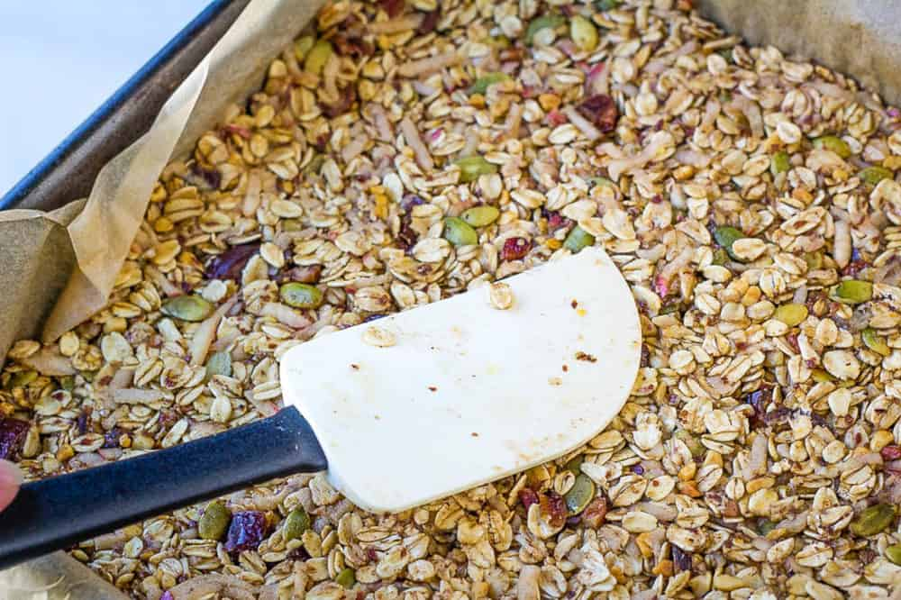 healthy flapjacks being pressed into a baking dish