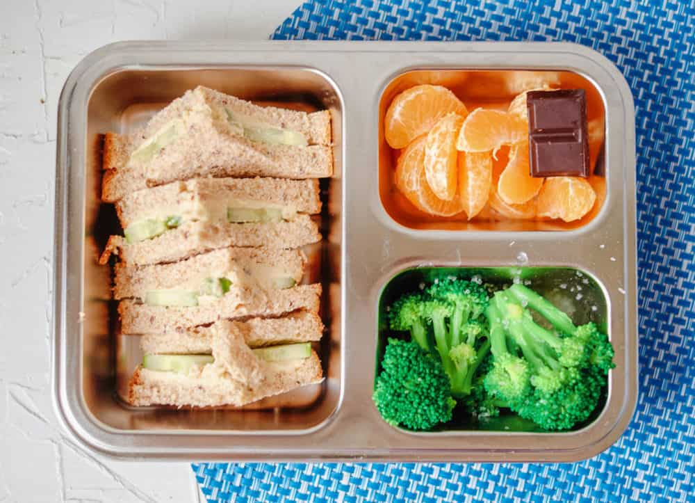 Healthy Toddler lunches - sprouted wheat sandwich with hummus, cucumbers, oranges, broccoli