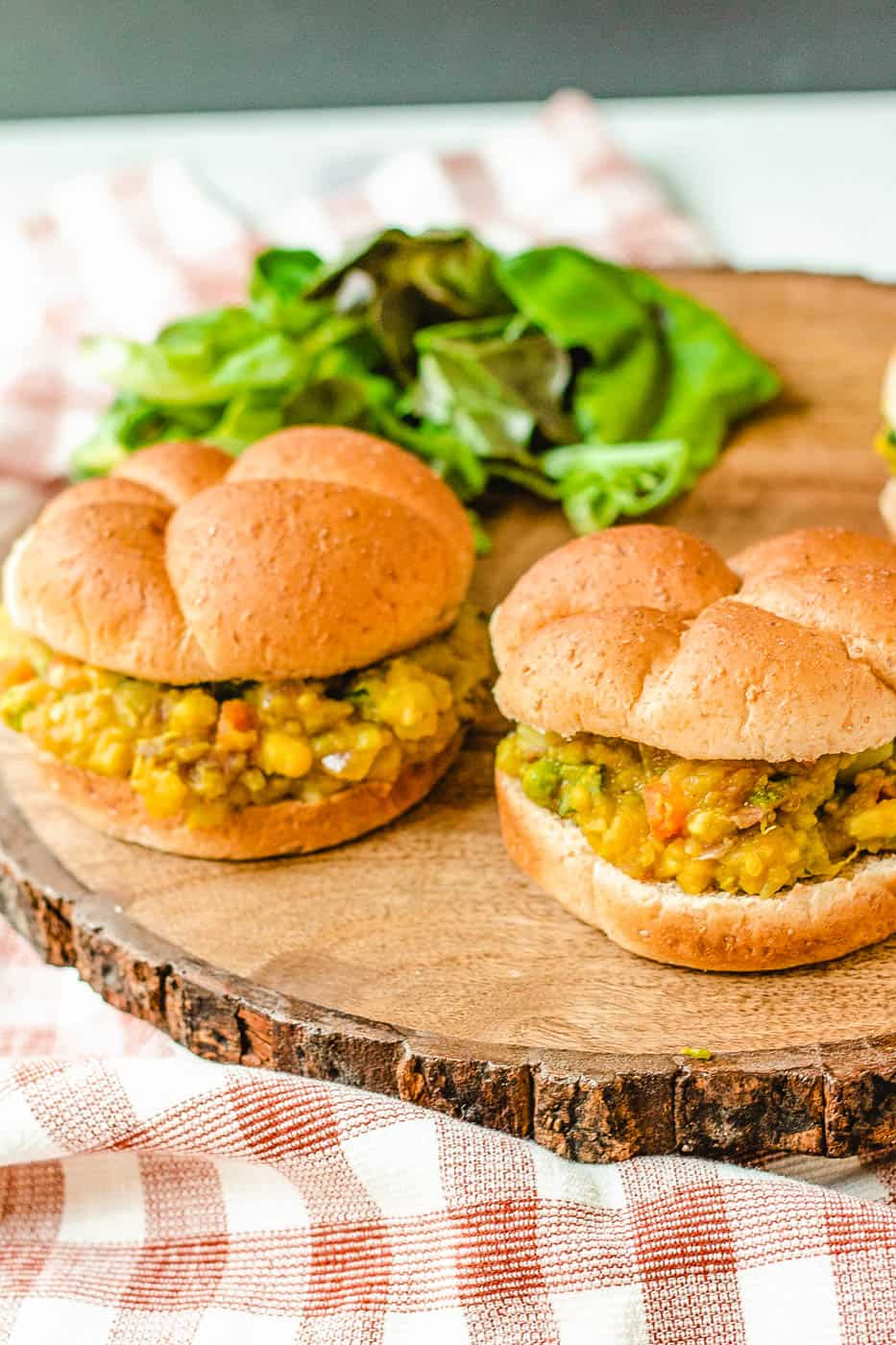Pav Bhaji (or Indian Spiced Vegetarian Sloppy Joes) served on a wooden cutting board with a wheat bun