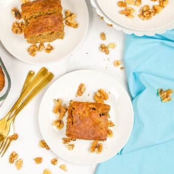 easy vegan banana bread recipe, served on a white plate with a blue napkin in the background