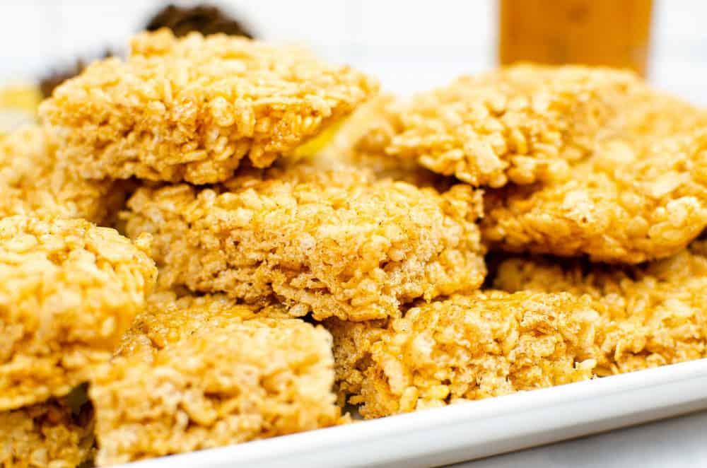 vegan rice krispie treats with pumpkin spice on a white platter