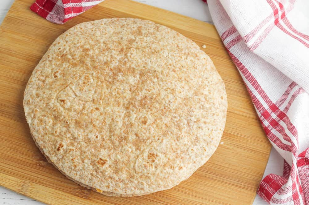 whole wheat tortilla on a cutting board