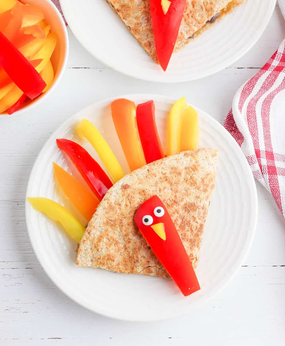 cheese quesadilla shaped like turkeys, with bell peppers, beans and cheese