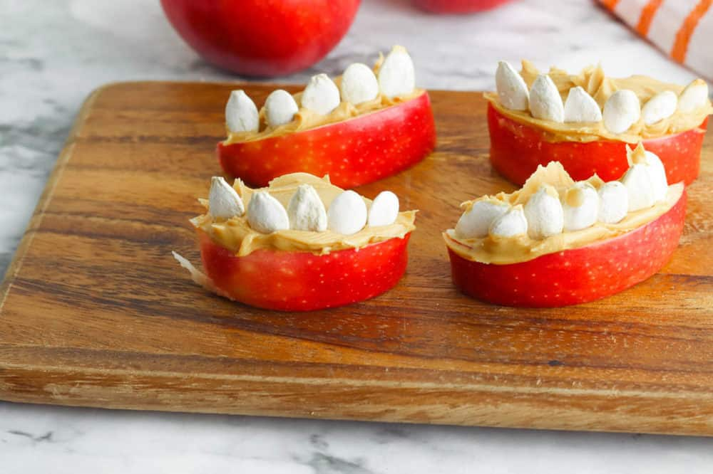 apple slices with peanut butter and pumpkin seeds