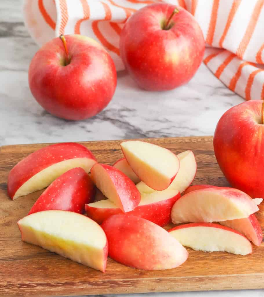 apple slices on a wooden cutting board