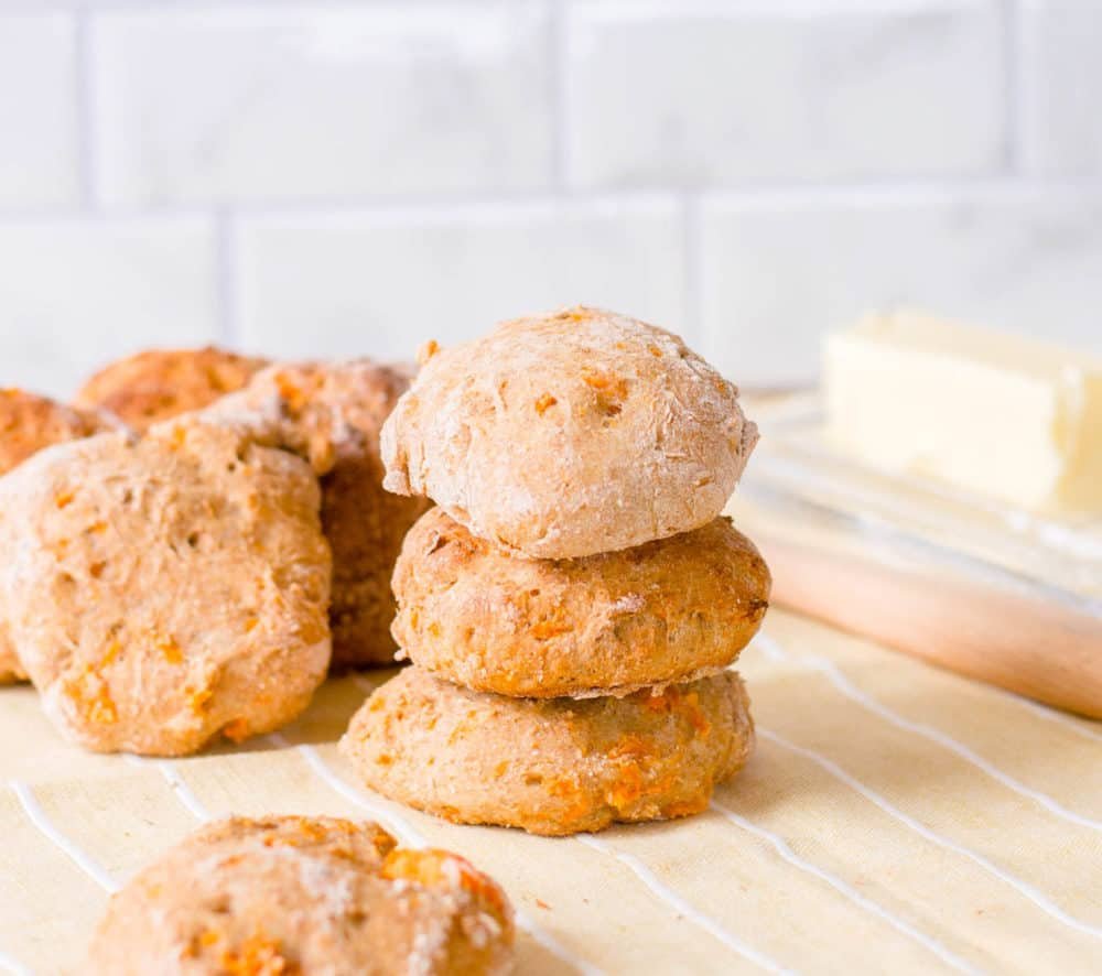 low calorie healthy biscuits made with sweet potato, stacked against a yellow and white background