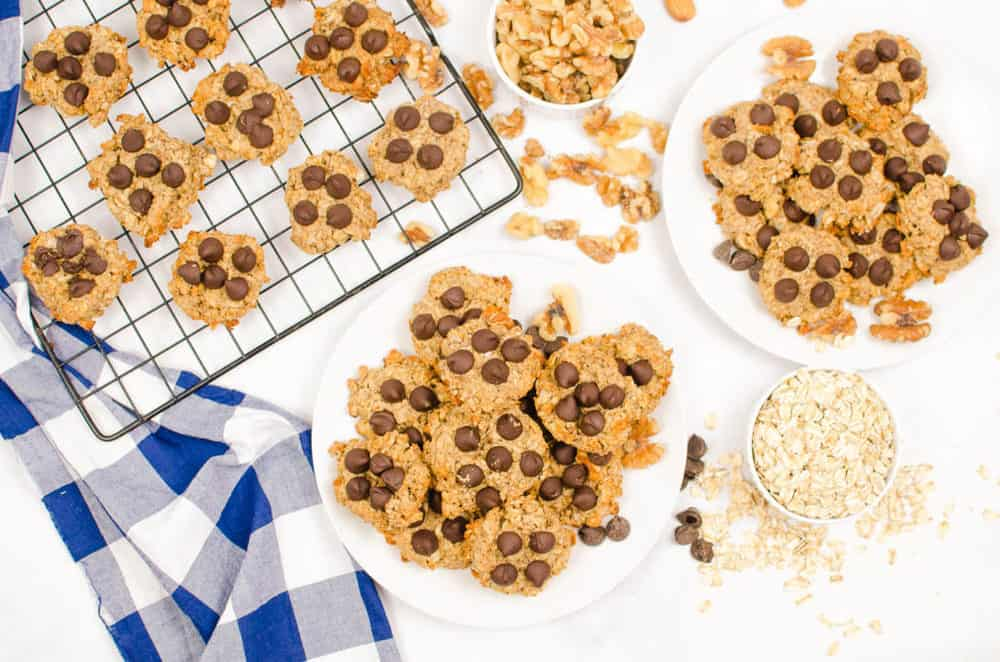 vegan peanut butter banana oatmeal cookies served on a white plate, topped with chocolate chips