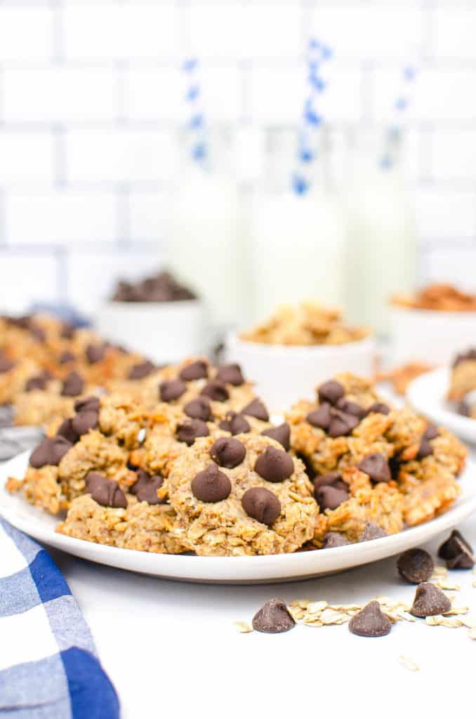 peanut butter banana oatmeal cookies served on a white plate, topped with chocolate chips