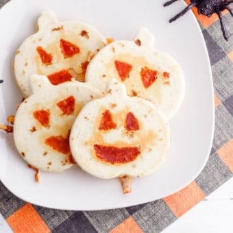 halloween jack-o-lantern pumpkin quesadillas served on a white plate