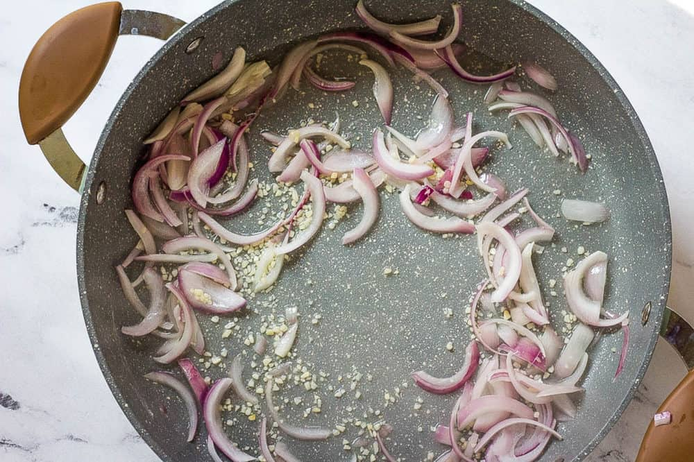 onions and garlic sauteeing in a pan