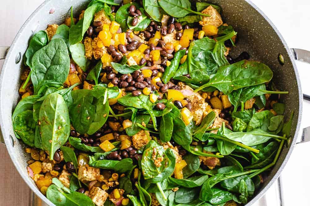spinach and black beans added to pan