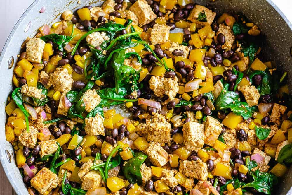 finished dish in a pan with veggies and black beans