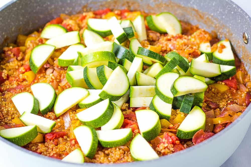 zucchini and quinoa cooking in a large pot