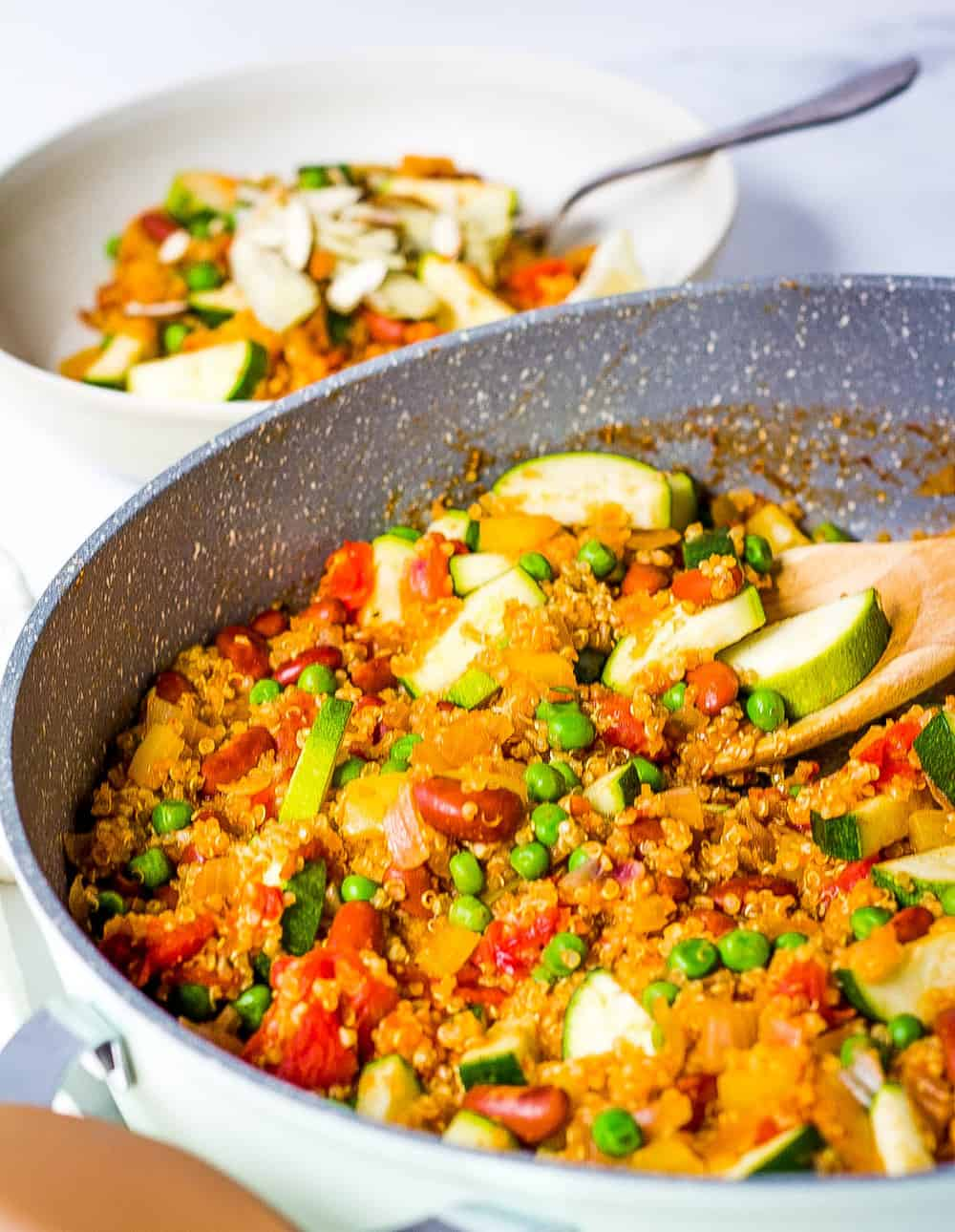 finished vegetarian paella made with fresh vegetables and quinoa