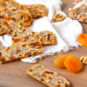 gluten free biscotti with apricots and walnuts on a wooden cutting board