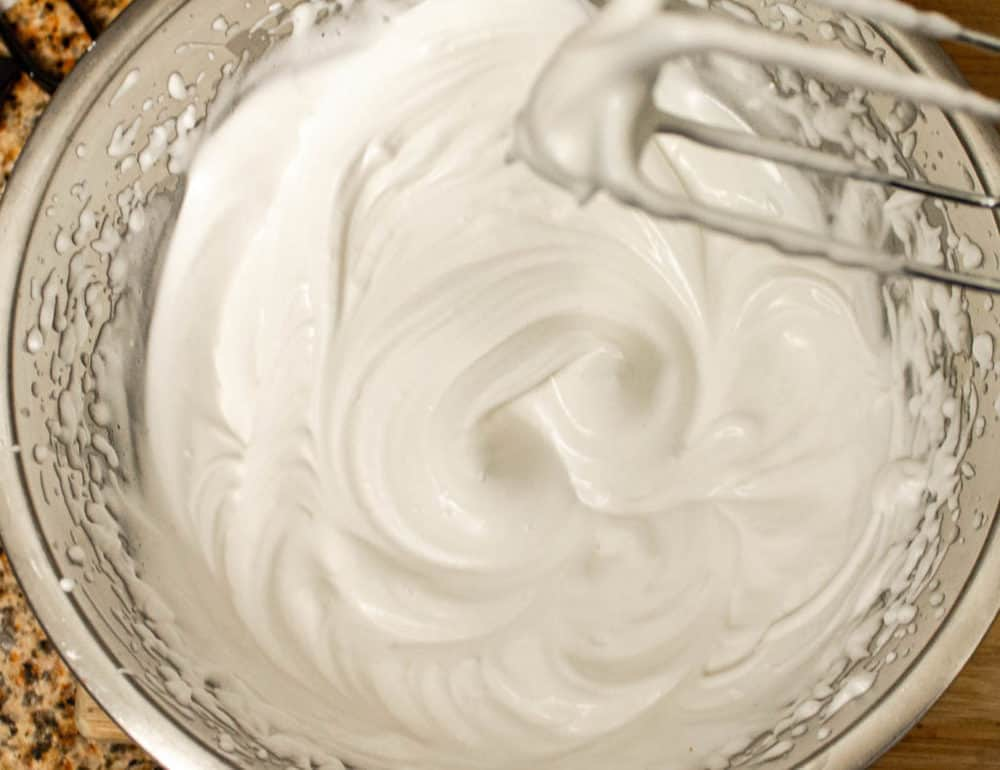 aquafaba whipped in a mixing bowl